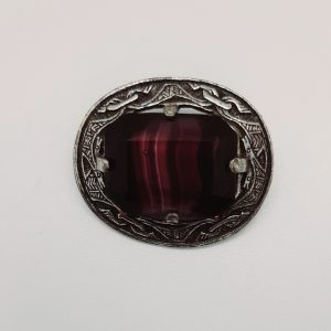 purple celtic brooch